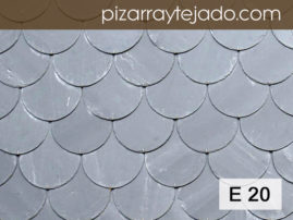 Foto de pared de pizarra natural formato redondeada.
