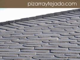 E 10M. Foto de pizarra para tejado. Detalle de limatesa de pizarra natural.