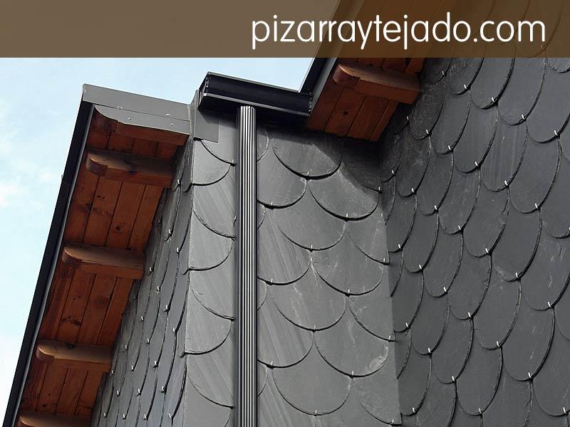 Colocaci n de pizarra en fachada sobre tejado y pared for Fachadas de pizarra