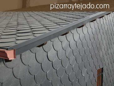 Colocación de pizarra en fachada, sobre tejado y pared vertical. Pizarra natural de León.