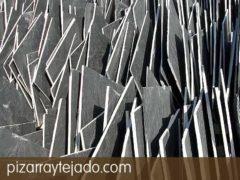 Comercialización de pizarra natural color negro y formato irregular. Pizarra de La Baña (León, España).  Pizarra en rama. Pizarra granel.