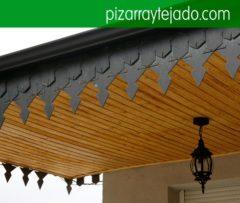 Teulada de pissarra. Remate de alero tejado de pizarra. Pissarra per cobertes, teulades i façanes. Venta y colocación de pizarra de León.