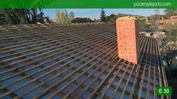 Colocación de triple rastrel en tejado de pizarra en Madrid. Cubierta pizarra Madrid.
