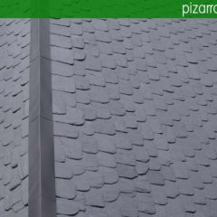 Cumbrera de zinc en tejado de pizarra